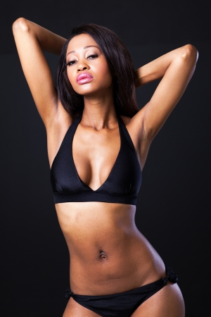 sexy african american fashion model on black background photo