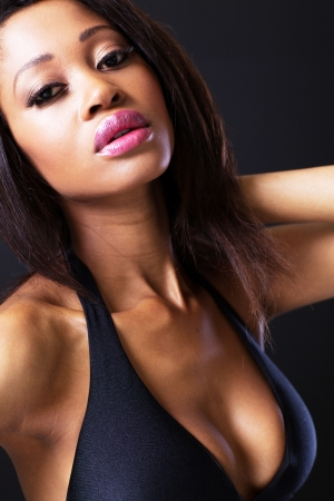 bra model: pretty african american fashion model on black background Stock Photo
