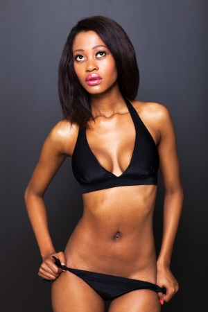 sexy young african american model on black background photo