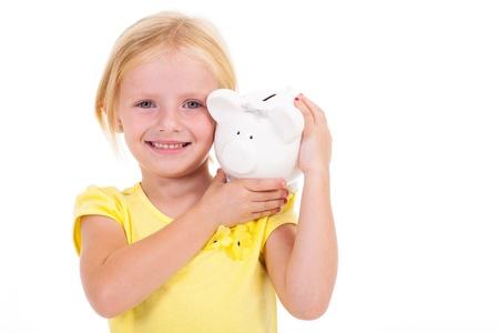 piggybank: cute little girl carrying piggybank on her shoulder