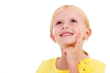 happy little girl daydreaming on white Stock Photo - 17331341