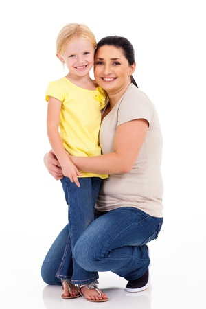 happy mother hugging little daughter on white background photo