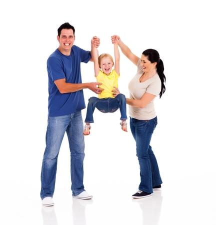 family tickle: fun young parents playing with little daughter isolated on white