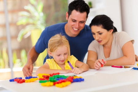happy parents watching little daughter drawing picture Stock Photo - 17365249