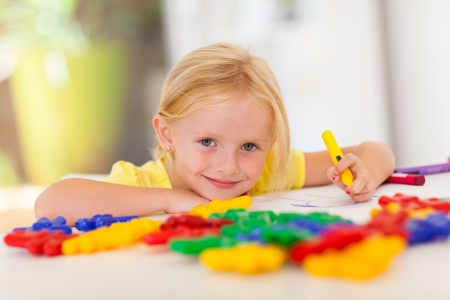 cute little girl drawing with crayon at home Stock Photo - 17331668