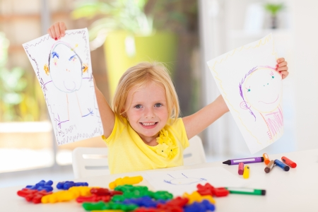 proud little girl showing her drawing at home Stock Photo - 17331621