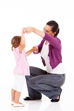 modern parents: young mother playing with little daughter on white Stock Photo