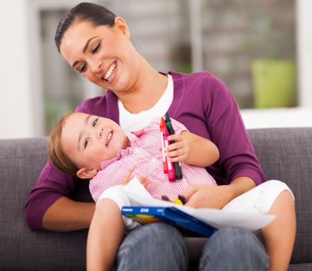happy mother playing with little daughter at home Stock Photo - 17424219