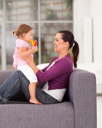 happy mother playing with daughter at home Stock Photo - 17365248