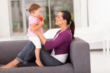 happy mother and little daughter at home Stock Photo - 17365242
