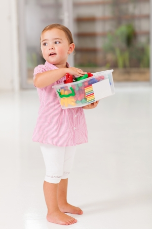 toy box: cute little girl holding box of toy