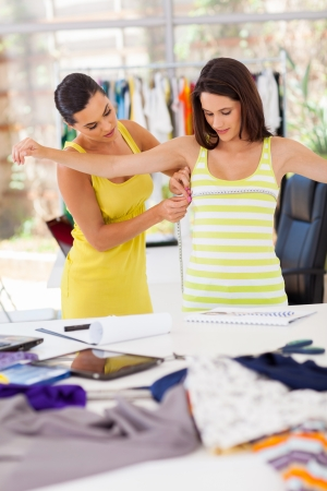 tailor measure: female dressmaker measuring clients bust size Stock Photo