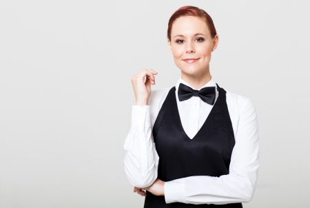 attractive young waitress in uniform photo
