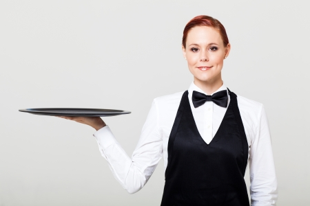 black tie: pretty waitress with an empty tray Stock Photo