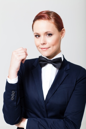 navy blue suit: cute young woman in suit with bow tie