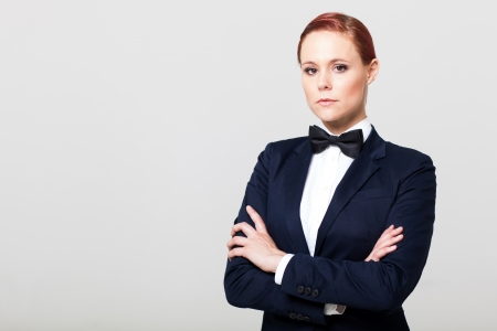 navy blue suit: attractive fashion woman in suit with bow tie