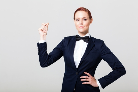 navy blue suit: cute fashion woman in suit with bow tie