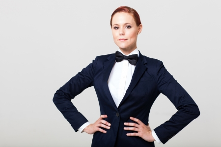 navy blue suit: pretty fashion woman in suit with bow tie
