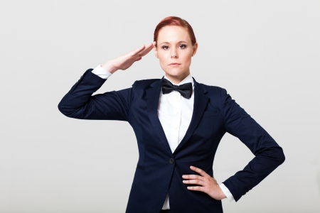 navy blue suit: cute fashion woman in suit with bow tie salute