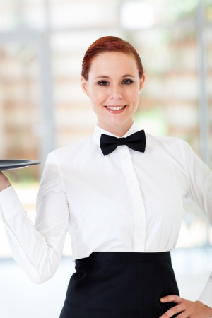 beautiful waitress holding a tray in modern restaurant photo