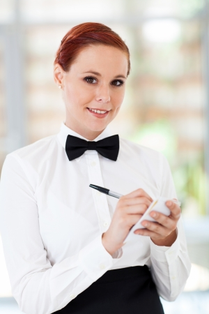 pretty waitress taking orders in restaurant photo