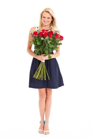 pretty young woman holding bunch of roses isolated on white photo