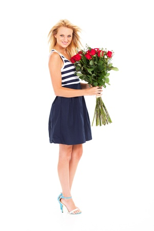 pretty blonde woman holding bunch of red roses isolated on white photo