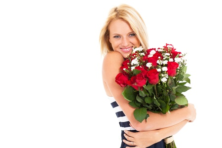 pretty blonde woman holding bunch of roses photo