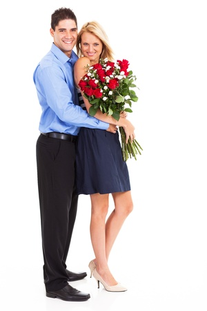 young couple with bunch of roses full length portrait photo