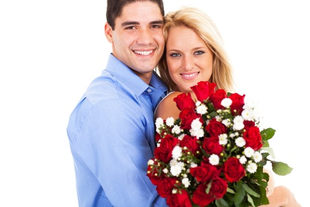 loving young couple with roses on valentines day photo