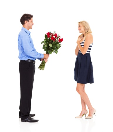 gift giving: young man giving bunch of roses to a girl on valentines day Stock Photo