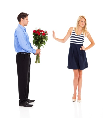 rejection sad: young man been rejected by a young woman on valentines day