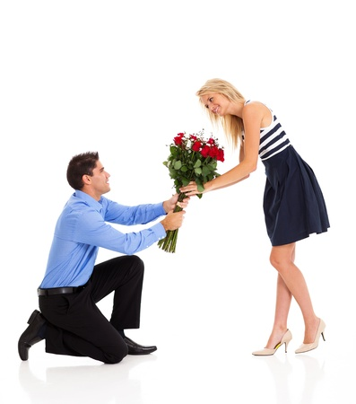 young woman accepting roses from a man on valentines day photo