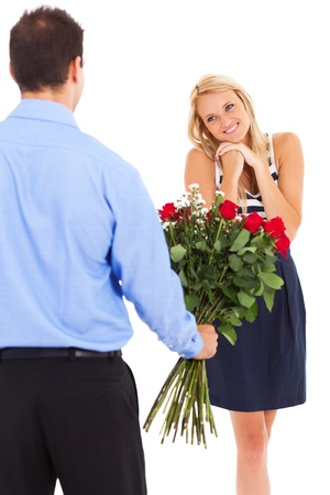 happy woman receiving roses from a young man  photo