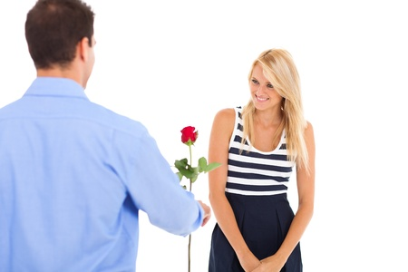 giving back: young man giving rose to a beautiful young woman Stock Photo
