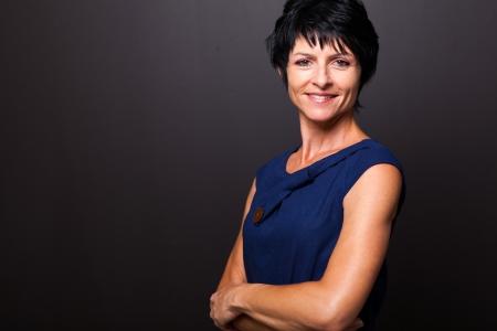 cute middle aged woman portrait on black photo