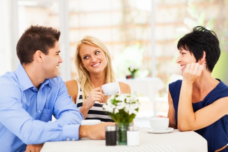 a marriage meeting: happy young man meeting mother in law with his wife