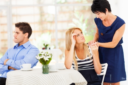 mother in law: caring mother standing by her daughter when she has marriage problem Stock Photo