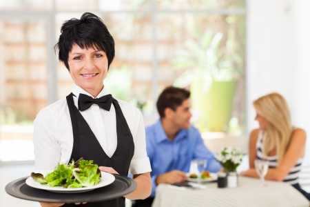 pretty middle aged waitress working in restaurant Stock Photo - 17553370