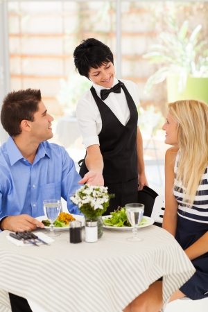 happy waitress serving customers in cafe Stock Photo - 17452600