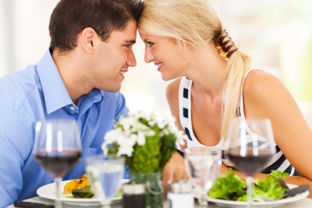 wine and dine: loving young couple dining out in restaurant