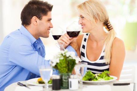 dining out: loving young couple drinking wine in restaurant