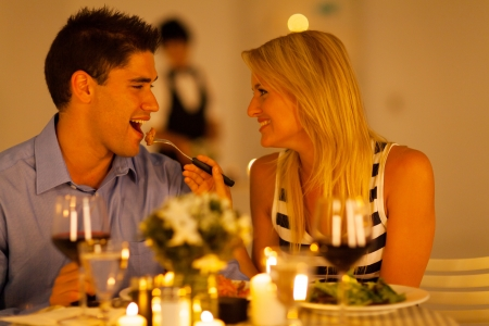 romantic dinner: loving couple having romantic dinner in a restaurant