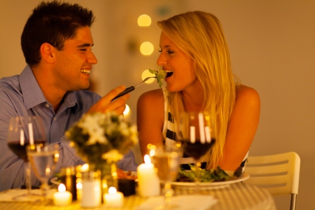 young couple having romantic dinner together in a restaurant photo