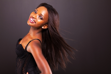 pretty african american woman with long hair on black background Stock Photo - 17457231