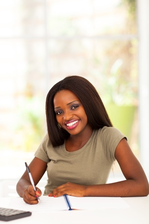 pretty african american college student studying at home Stock Photo - 17457277