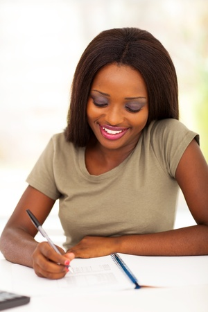 famale: happy african famale college student studying