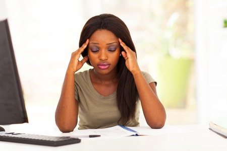 young female african american college student having headache photo