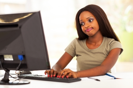 cute african american young woman chatting online photo
