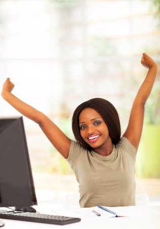 young african university student stretching before computer Stock Photo - 17457294